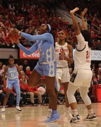 Sophomore center Janelle Bailey (44) prepares to make a basket during the game against NC State on Sunday, Feb 3, 2019 at Reynolds Coliseum. The UNC women's basketball team beat NC State 64 - 51.
