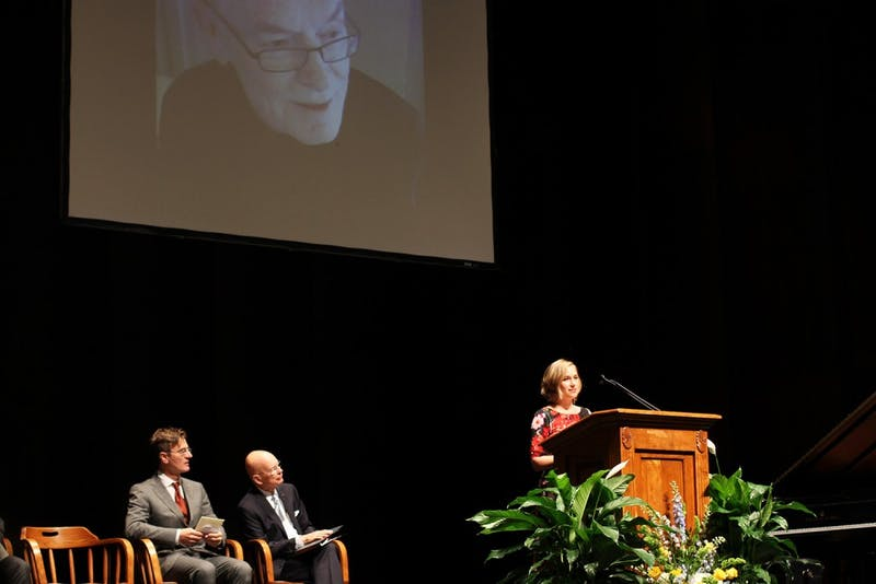 (From left to right) Federico Luisetti, former chancellor James Moeser and Alisa Eanes, former Covenant Scholar, offer their reflections during the memorial service for the late Fred Clark in Memorial Hall on Saturday.