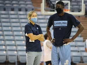 UNC women's basketball coach Courtney Banghart and Director of Player Personnel Jackie Manuel talk during a preseason practice in Carmichael Arena on Sept. 29, 2020. Photo courtesy of Dana Gentry.