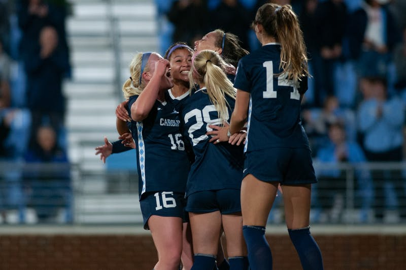 UNC's women's soccer team celebrates Maycee Bell's (25) goal against USC during the NCAA quarterfinal game at Dorrance Field on Friday, November 29, 2019. Bell scored. the game winning goal to advance the  Tarheels to the semifinals with a score of 3-2.