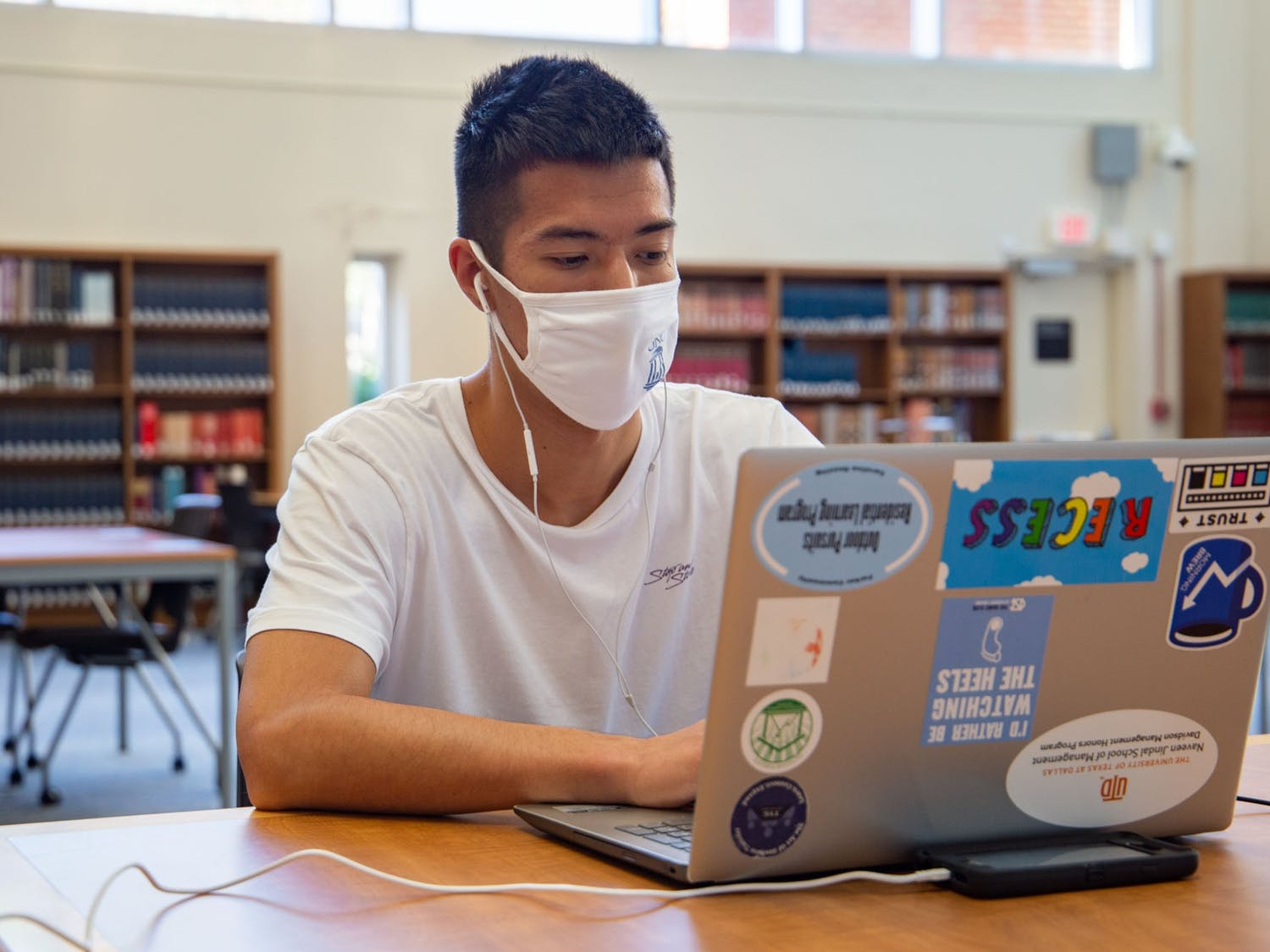 A student studies in Davis Library on Thursday, Oct. 8, 2020, and many students seem to be returning to reopened study spaces on campus.
