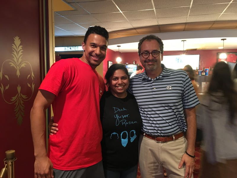 Jordan Sawyers, Kaushal Ghandi and School of Dentistry Dean Scott De Rossi pose at the Varisty Theatre at a talent show in honor of Yusor Mohammad Abu-Salha, Deah Shaddy Barakat and Razan Mohammad Abu-Salha.