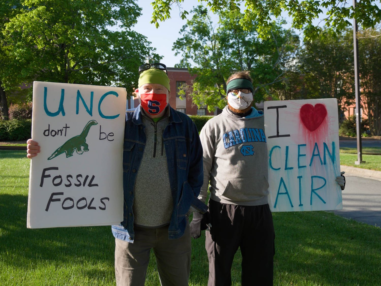 Gary Richards and Will Zang pose for a portrait in front of UNC's coal plant on Friday, Apr. 23, 2021.