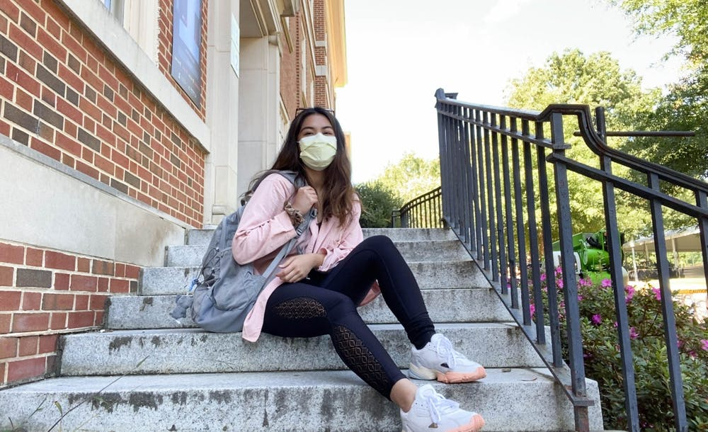 Carryle Jane Arroyo, a junior at UNC studying psychology, poses for a FaceTime portrait outside Dey Hall. She is planning on studying abroad at Korea University in the spring.