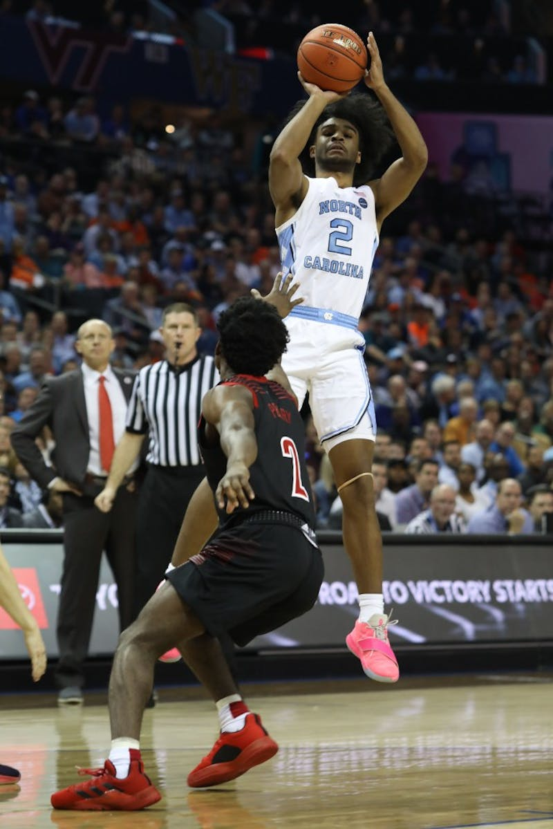 First-year guard Coby White (2) shoots a three-pointer against Louisville in the quarterfinals of the ACC tournament on Thursday, March 14, 2019 at the Spectrum Center in Charlotte, N.C. UNC defeated Louisville 83-70 to advance to the semifinals.