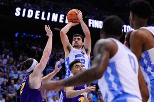 Forward Luke Maye (32) pulls up for a jump shot against Northern Iowa on Friday in the Smith Center.