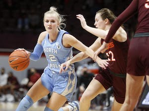 Graduate transfer guard Petra Holešínská dribbles around a defender during UNC's 73-69 loss to Virginia Tech at Cassell Coliseum in Blacksburg, Virginia, January 31 2021. Photo courtesy of Jon Fleming.