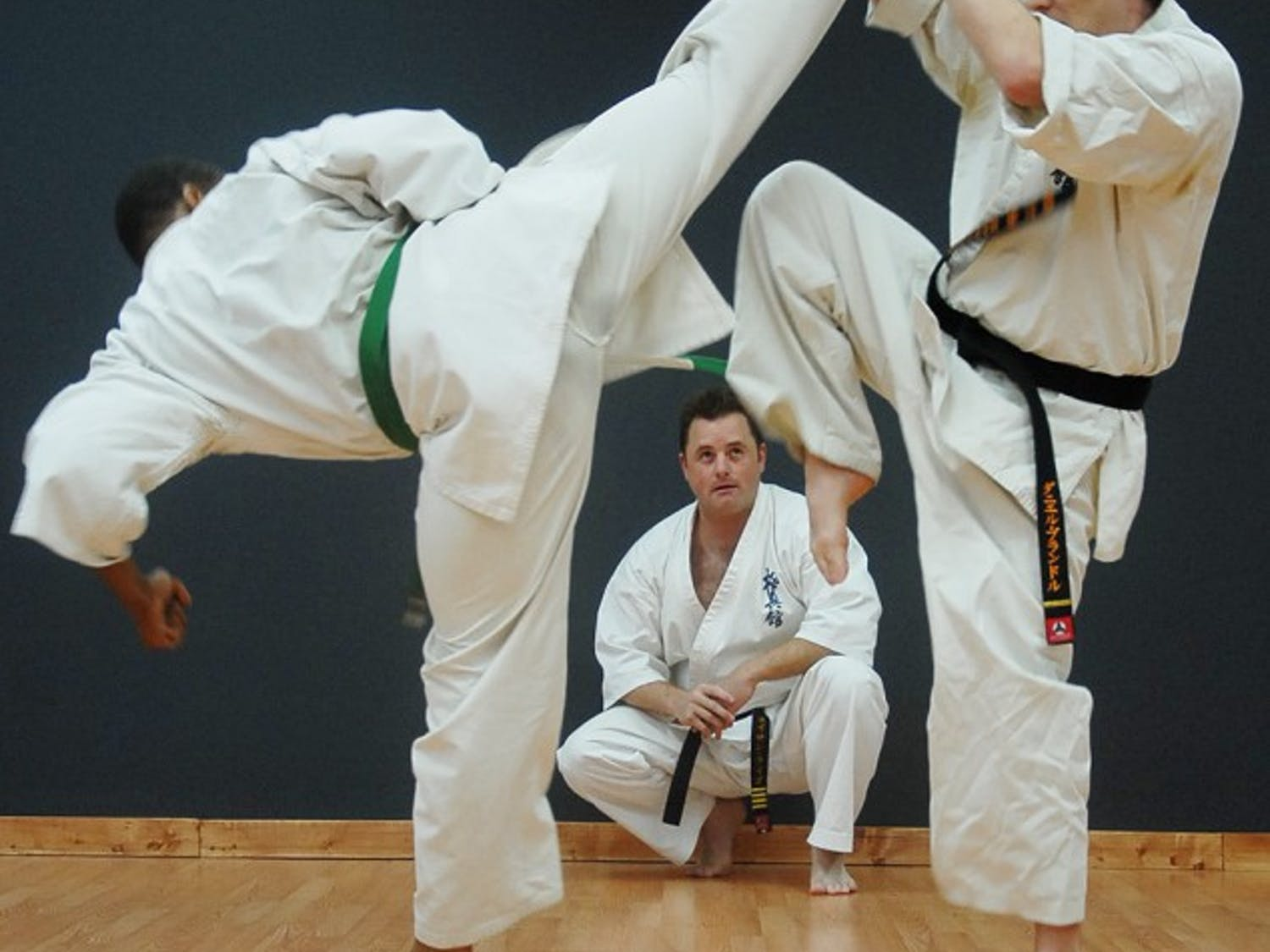 Instructor Nathan Ligo mentors Daniel Brandl and Donald Harris, two of five of his instructors for his Karate studio on Monday night. Donald Harris (left) is fighting in Japan next week.