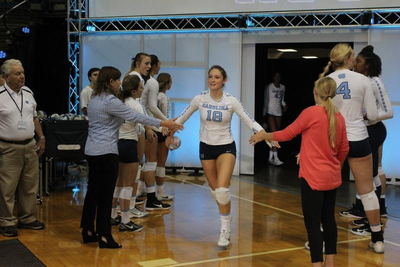 UNC defensive specialist Sehrena Hull (18) walks onto court in Saturdays game against UVA.