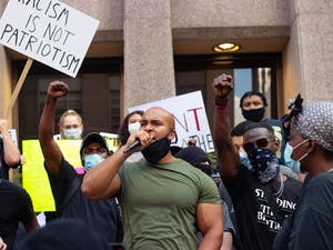 Social justice activist Kerwin Pittman speaks out against police brutality in reponse to George Floyd's death at the #RaleighDemandsJustice protest in downtown Raleigh on Saturday, May 30, 2020. This Saturday, many local organizations came together to hold a non-violent protest in Raleigh in solidarity with the other protests happening across the country.
