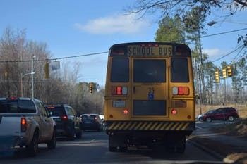 A school bus drives down MLK Jr. Blvd., on Monday, March 4, 2019. The Orange County Board of Education passed a new resolution in which the board refuses to share information regarding the immigration status of students and their families to immigration agents. This comes after more than 200 North Carolina residents were arrested by Immigration and Customs Enforcement agents in the past month.