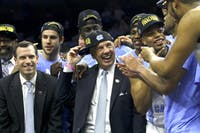 North Carolina men's basketball head coach Roy Williams celebrates with his team after winning a spot in the Final Four.
