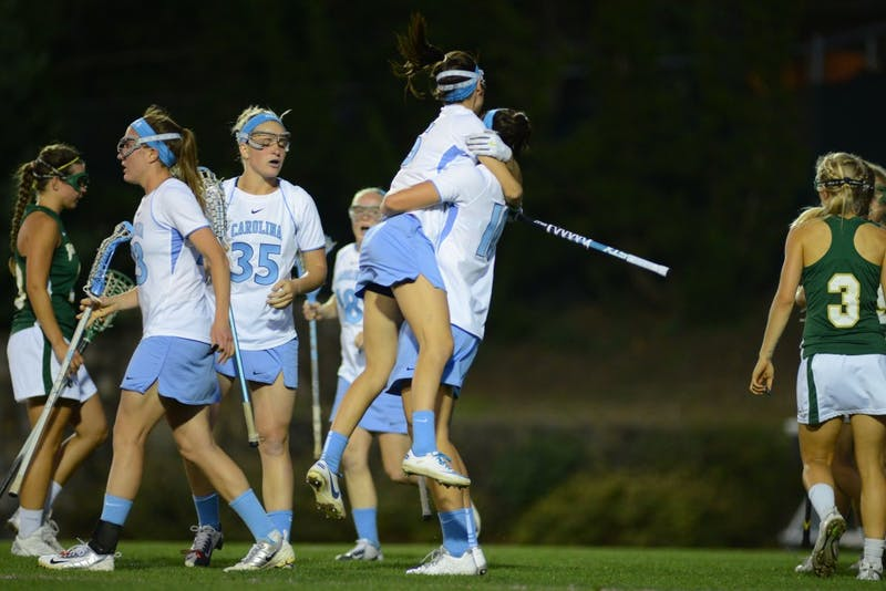 UNC senior midfielder Jessica Griffin (10) celebrates with senior midfielder Kara Cannizzaro (15) after Griffin scored a goal in the second half.