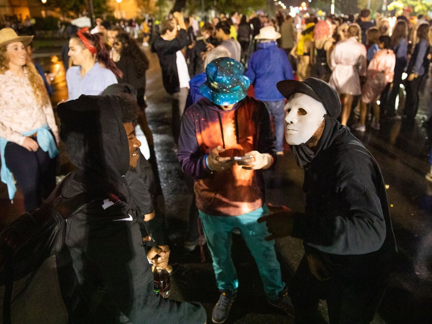 Three revelers gather on Franklin Street to perform a rap-off during the annual Halloween on Franklin event on the night of Thursday, Oct. 31, 2019.