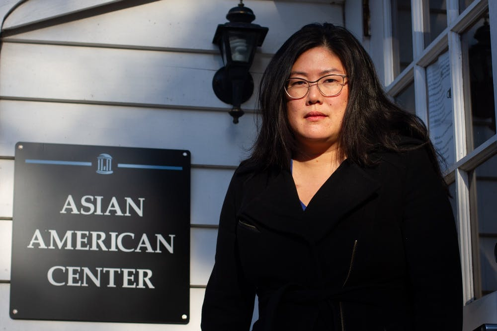 """Heidi Kim, an associate English professor and director of the UNC Asian American Center, poses for a portrait on Monday, Mar. 8, 2021. """"I've lived through multiple waves of anti-Asian American violence,"""" says Kim. """"You start to realize there's an underlying racism that's always there."""""""
