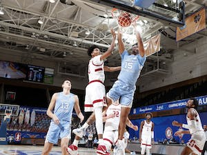 UNC's senior guard Garrison Brooks (15) dunks the ball during a game against Stanford during the Maui Invitational Tournament in Asheville, N.C. on Tuesday, Dec. 1, 2020. Photo courtesy of Brian Spurlock/Camping World Maui Invitational
