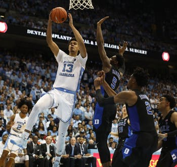 Senior guard Cameron Johnson (13) goes for a layup against Duke at the Smith Center on Saturday, March 9, 2019. UNC defeated Duke 70-79 on Senior Night to finish the season as ACC regular season champions.
