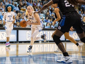 UNC senior guard Taylor Koenen (1) dribbles toward the net in Carmichael Arena on Sunday, March 1, 2020. The Blue Devils beat the Tar Heels 73-54.