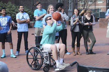 UNC Best Buddies held a wheelchair basketball game in front of Davis Library on Wednesday. Players from the varsity and JV basketball teams participated.