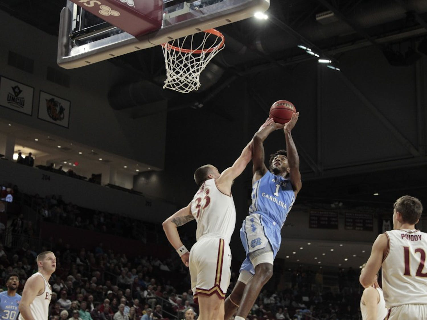 First-year guard Leaky Black (1) shoots against Elon forward Simon Wright (33) on Friday, Nov. 9, 2018 at the Schar Center.
