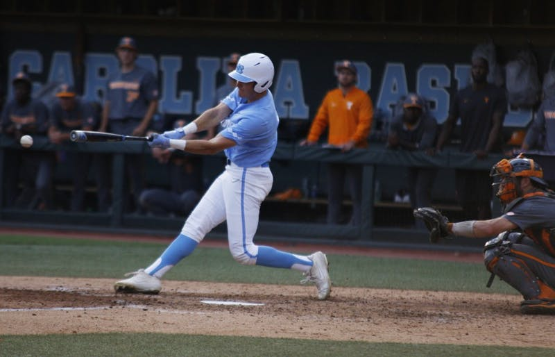 UNC baseball first-year and outfield, Caleb Roberts (11), hits the ball during the final game of the regional championships versus Tennessee on June 2, 2019. UNC won 5-2.