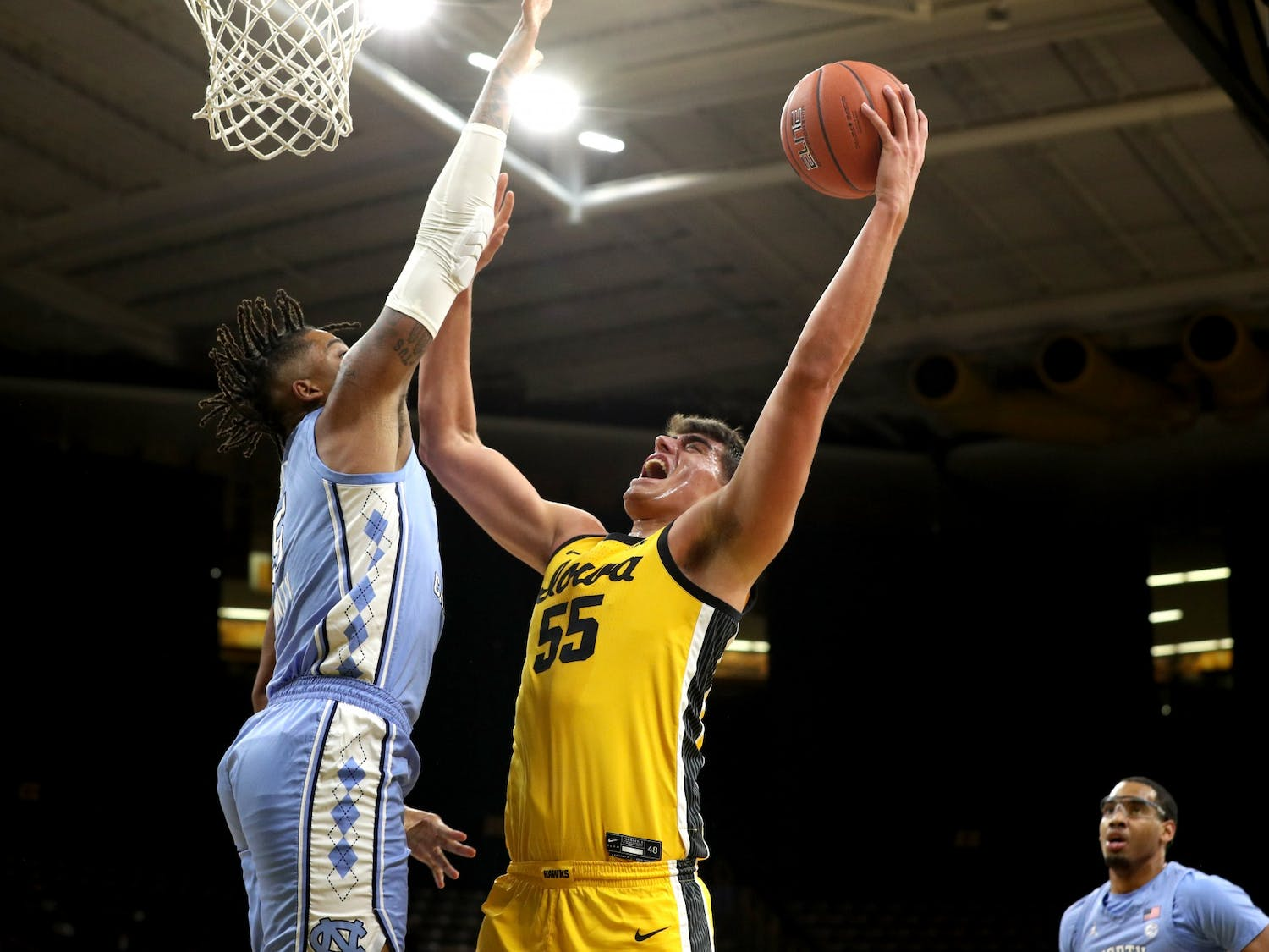 Iowa Hawkeyes center Luka Garza (55) goes to the hoop against the North Carolina Tar Heels Tuesday, December 8, 2020 at Carver-Hawkeye Arena. Photo courtesy of Brian Ray/hawkeyesports.com