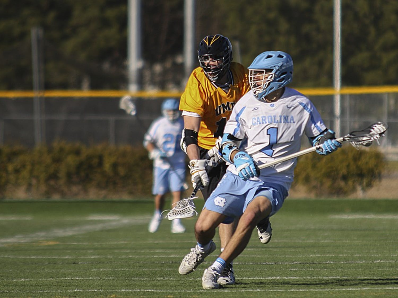 North Carolina attackman Luke Goldstock (1) moves up field against UMBC on February 4.