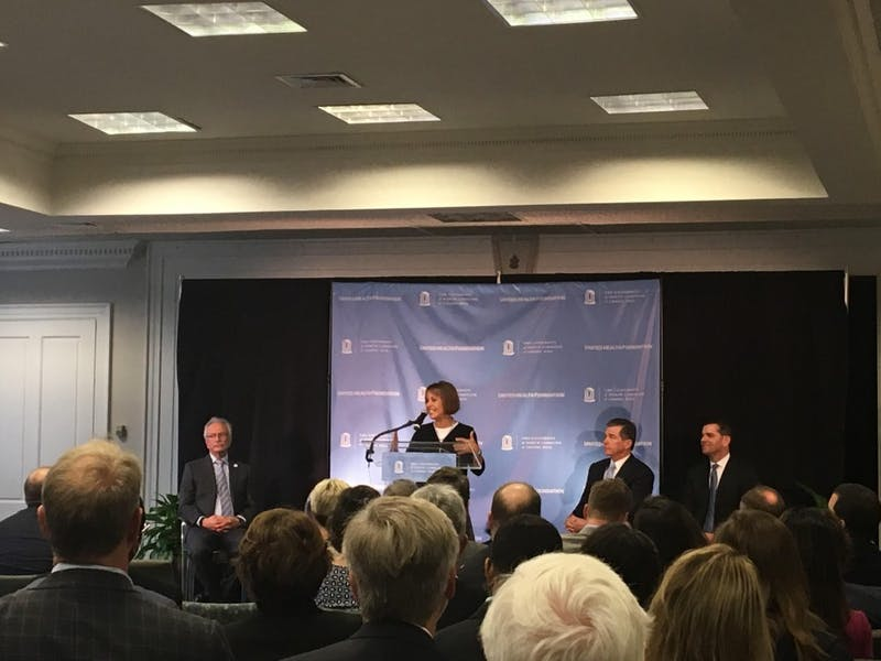 Chancellor Carol Folt announces why UNC is partnering with United Health Foundation. Gary Marchionini, dean of the UNC School of Information and Library Science, left, Gov. Roy Cooper, right, and UnitedHealth Group CEO David Wichmann, far right, were also in attendance for the announcement.