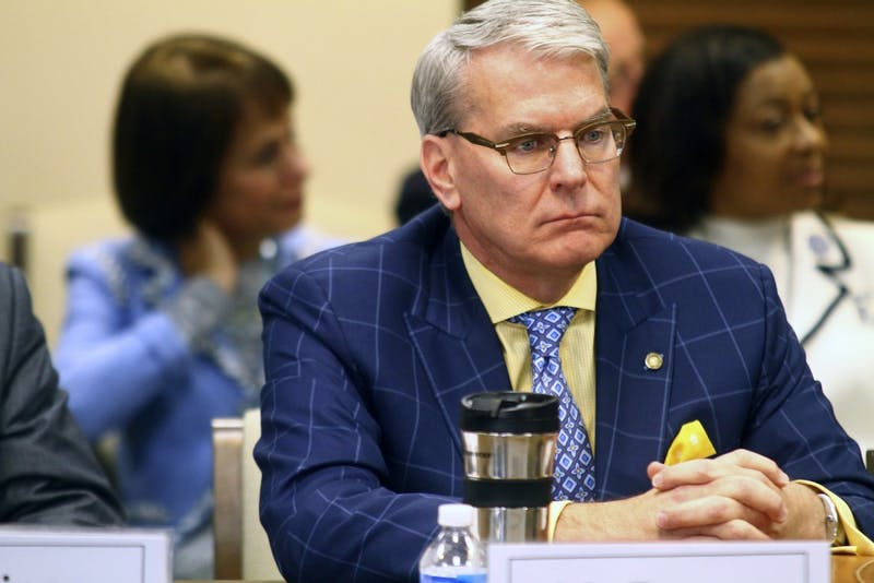 UNC-system Board of Governors member David Powers listens to president-elect Margaret Spellings' speech.
