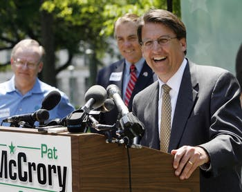 Republican nominee for Governor Pat McCrory, right, speaks to the crowd while his opponents in the primary, Bob Orr, left, and Fred Smith listen during a press conference/rally in downtown Raleigh, North Carolina Wednesday, May 7, 2008. (Chris Seward/Raleigh News & Observer/MCT)