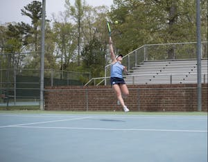 Junior Jessie Aney hits a volley against Pittsburgh on April 22 at the Cone-Kenfield Tennis Center.