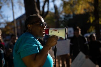 "Dorothy Faulkner, 55, of Chapel Hill, addresses a crowd gathered during a CEF-organized rally to call for affordable housing in front of the Community Empowerment Fund office on Friday, Nov. 1, 2019. ""It's in my heart to serve the Lord,"" Faulkner sung after her speech."