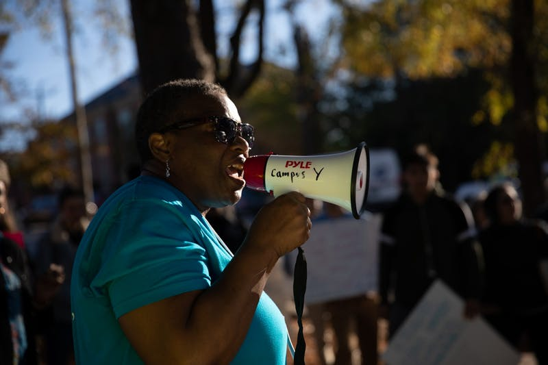 """Dorothy Faulkner, 55, of Chapel Hill, addresses a crowd gathered during a CEF-organized rally to call for affordable housing in front of the Community Empowerment Fund office on Friday, Nov. 1, 2019. """"It's in my heart to serve the Lord,"""" Faulkner sung after her speech."""