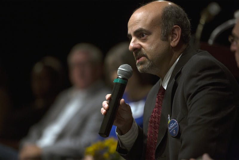Town Councilman David Shwartz speaks during the CHALT Forum at the Seymour Senior Center on Tuesday, 15, 2015. The forum allows Incumbents and candidates for Chapel Hill mayor and town council answer questions and share their views.