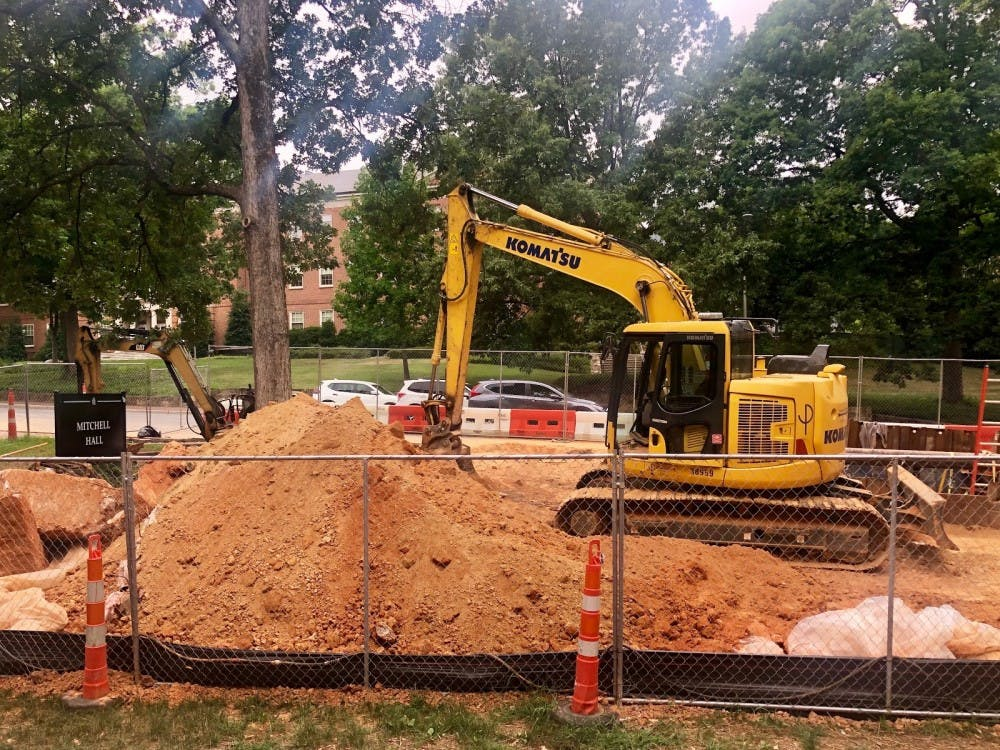 Fortifying beam falls, hospitalizing two construction contractors