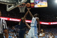 Forward Theo Pinson (1) attempts a layup during UNC's 83-66 win over Notre Dame on Feb. 12,  2018 at the Smith Center.