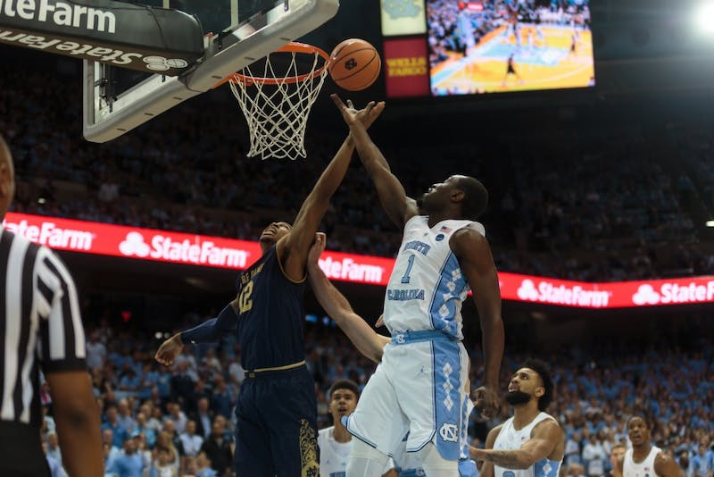 Forward Theo Pinson (1) attempts a layup during UNC's 83-66 win over Notre Dame on Feb. 12 at the Smith Center.