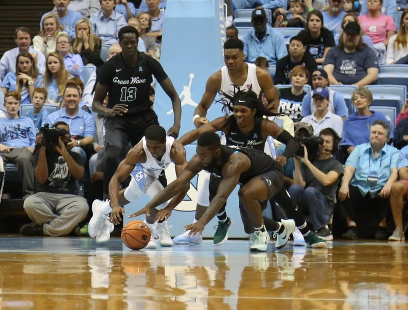 Guard Kenny Williams (24) dives for a ball against Tulane on Dec. 3 in the Smith Center.