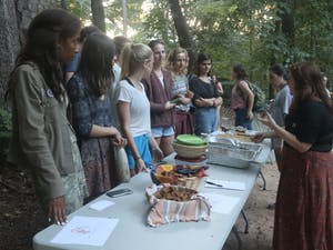 Students enjoy food, music, and poetry at the Harvest Moon Festival on Thursday night in the Forest Theatre.