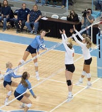 Junior Skylar Wine (6) spikes the ball during the game against Miami on Sunday Oct. 11 at Carmichael Arena. UNC won 3-1.