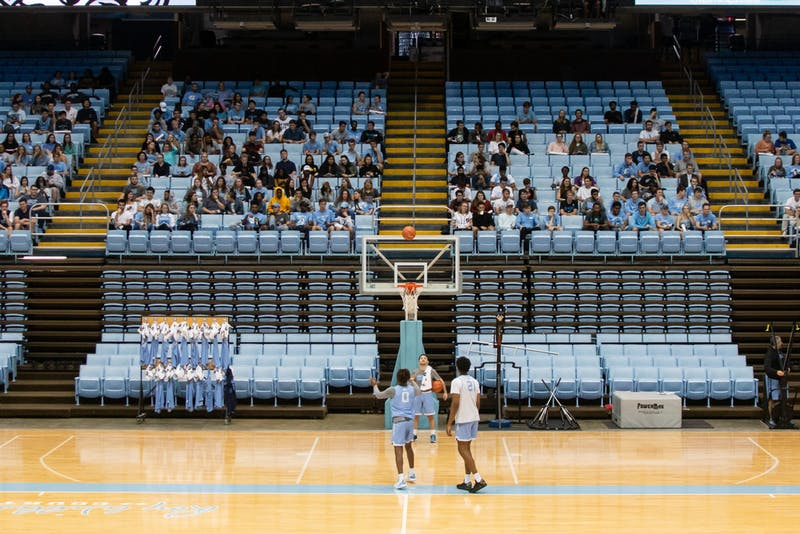 Students watch the UNC men's basketball team during an open practice in the Smith Center on Tuesday, Oct. 29th, 2019.