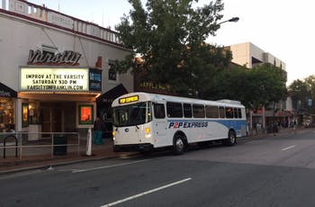 A P2P shuttle bus waits for passengers to board at Varsity Theatre bus stop on Franklin St.