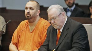 Murder defendant Craig Stephen Hicks, 46, left, listens while his co-defense counsel Terry Alford makes notes during a Monday, April 6, 2015 death penalty hearing for Hicks in Durham, N.C. Presiding Judge Orlando Hudson found the shooting deaths of three Muslim college students at Finley Forest residential complex in Chapel Hill in February 2015 made the Hicks case eligible for the death penalty. (Harry Lynch/Raleigh News & Observer/TNS)