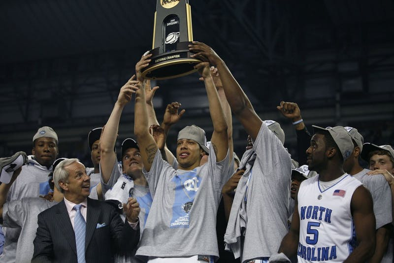 Danny Green raises the 2009 NCAA championship trophy with his team. Green has since gone on to win the NBA championship with the San Antonio Spurs.