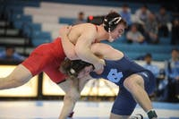 UNC senior Chip Ness suffers a takedown from Cornell sophomore Max Dean in a bout lost 2-3. No. 9 Cornell defeated UNC 29-5 on Saturday, Feb. 17, 2019 in the Carmichael Arena.