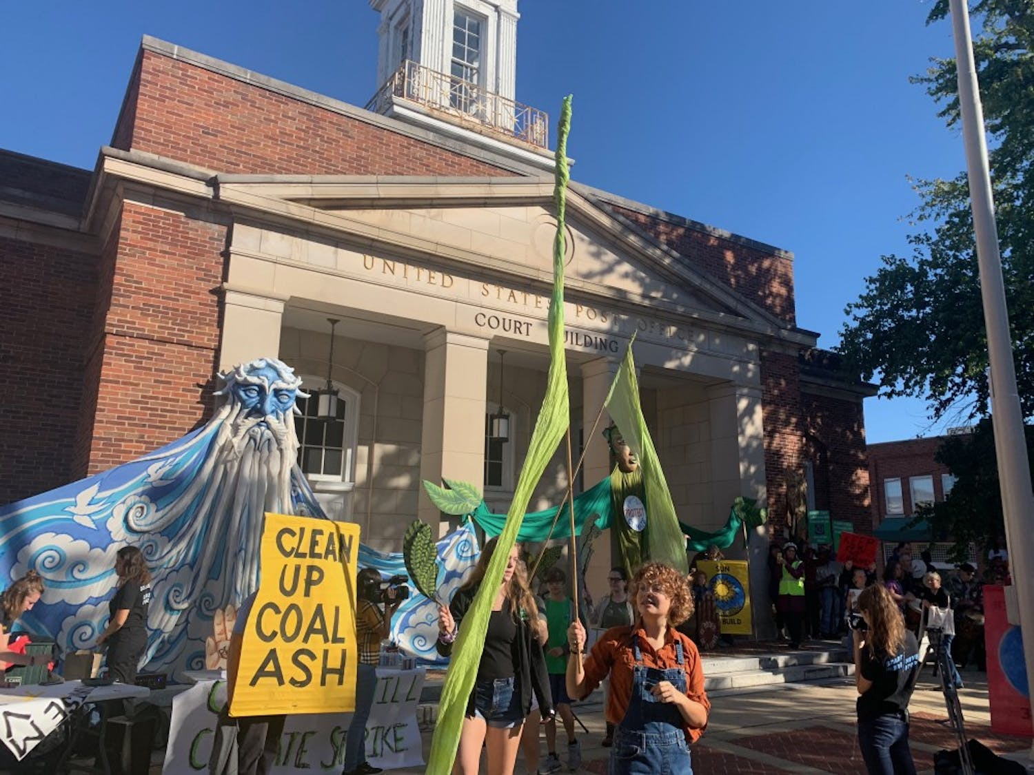 Community activists gather outside of the Chapel Hill Courthouse at the Peace and Justice Plaza on Sept. 20 for the Chapel Hill Climate Strike.