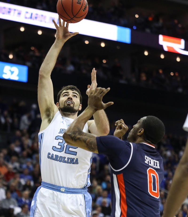 Auburn senior forward Horace Spencer (0) guards UNC senior forward Luke Maye (32) during UNC's 97-80 loss against Auburn in the Sweet 16 of the NCAA Tournament on Friday, March 29, 2019 at the Sprint Center in Kansas City, M.O.