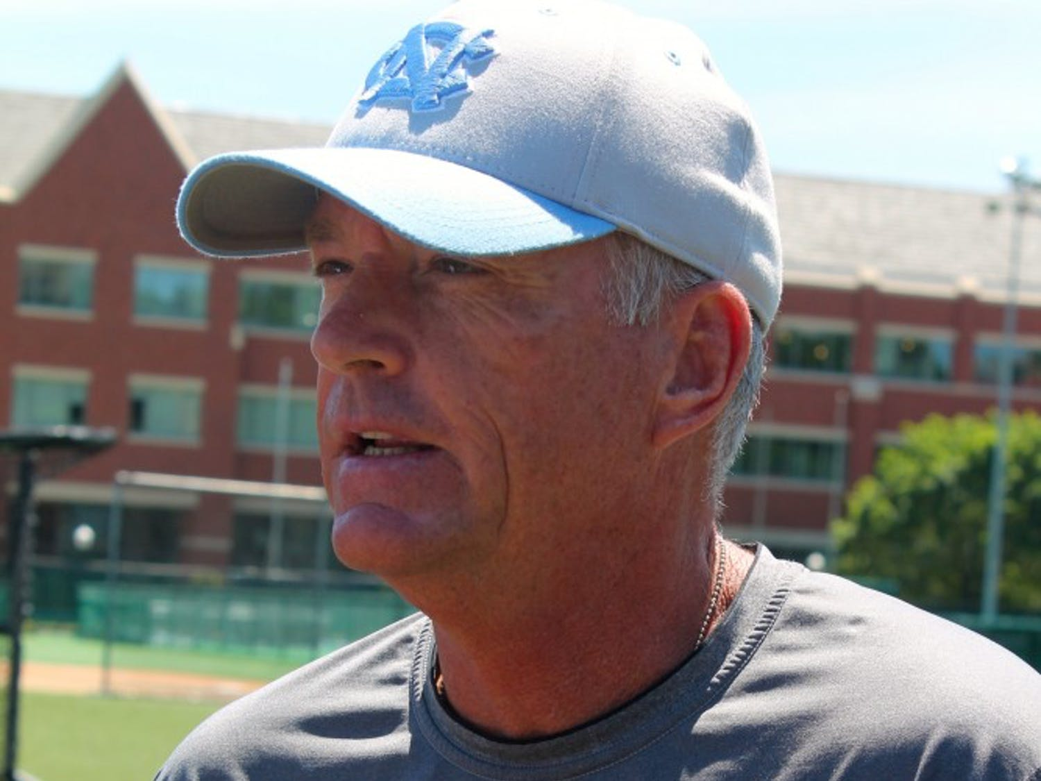 Coach Mike Fox addresses the media after Monday afternoon's practice at Creighton's field.