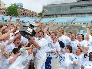UNC senior captain Marcus Holman (1) hoists the 2013 ACC Championship Trophy.