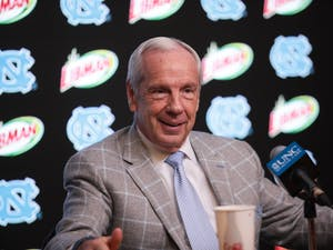 Head Coach Roy Williams speaks at a post-game press conference after a 94-71 win against Miami. The victory broke the Tar Heels' losing streak and allowed Williams to surpass Dean Smith in all-time wins.